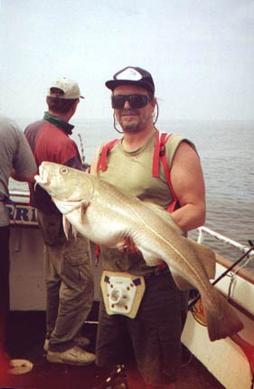 In the old days, Adam's muscular frame was capable of subduing large fish, such as this lovely cod